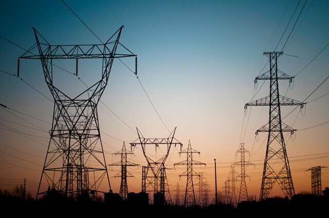 Electrical transmission towers carrying high-voltage lines