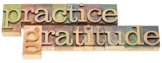 """The words """"practice gratitude"""" in wood type"""