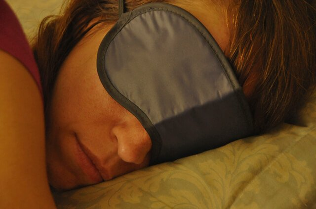 Sleep mask covers the eyes of Deanna Husk