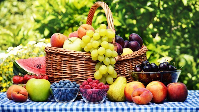 Basket of fresh fruits in a garden