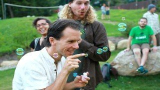 Dr. Samuel Mielcarski pokes bubbles next to Chris Kendall at The Woodstock Fruit Festival