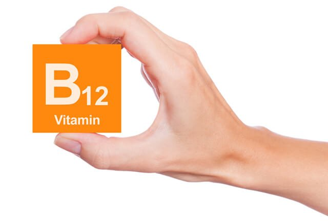 Hand holds Vitamin B12 block
