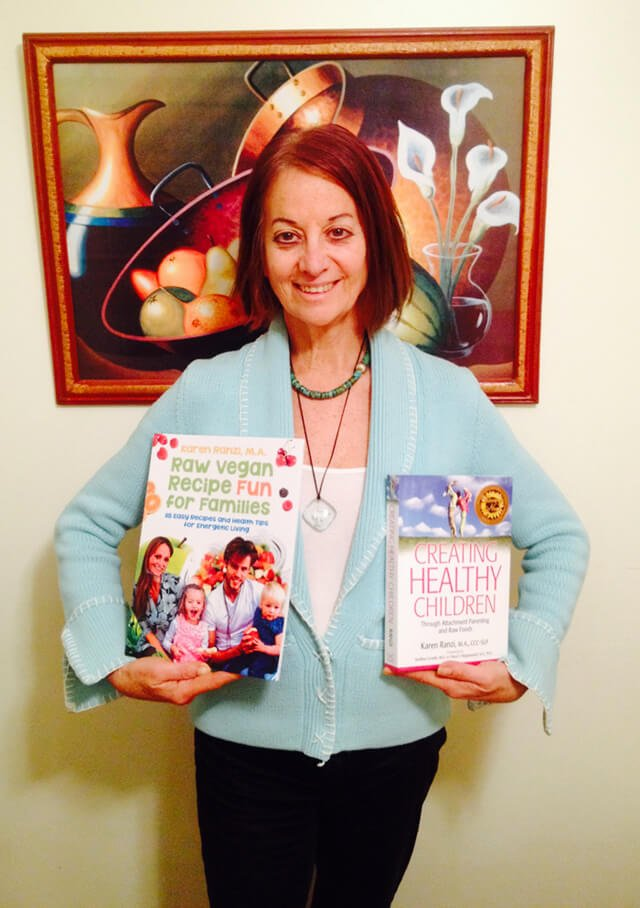 Karen Ranzi holds up her books