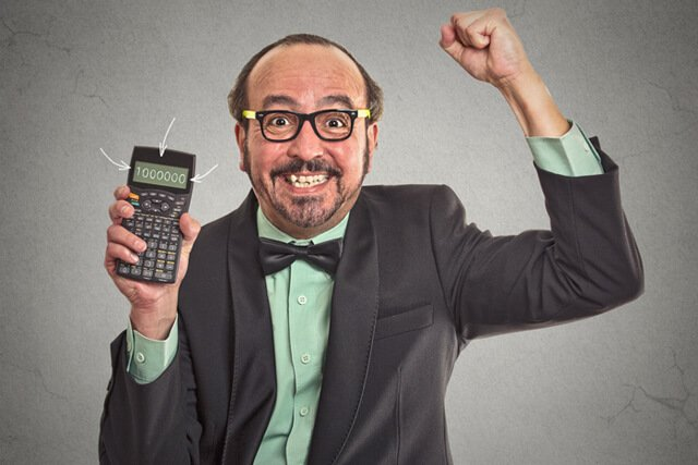 Happy businessman showing calculator with 1 million figure