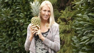 Natalie Lenka holds a pineapple