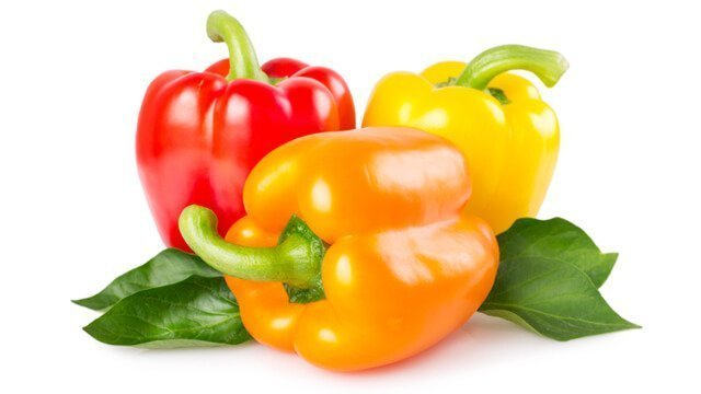 Yellow, orange and red peppers on a white background