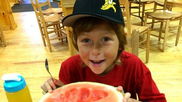 Raw Food Levi eats watermelon at The Woodstock Fruit Festival
