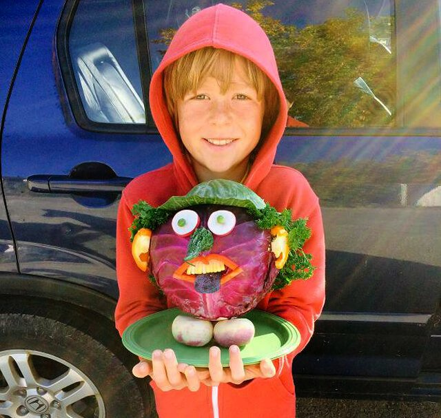Raw Food Levi holds a cabbage head for a 2014 contest