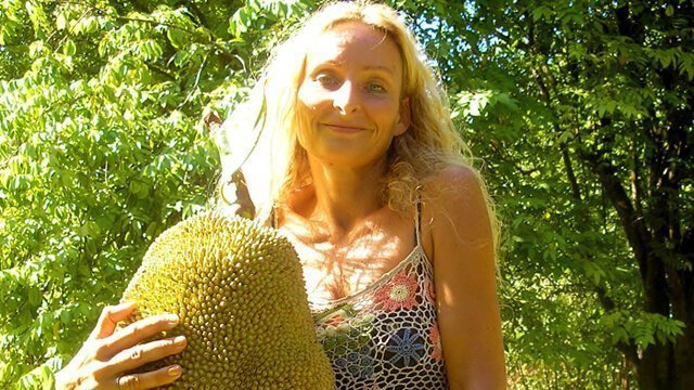 Anne Osborne holds a large jackfruit she foraged in February 2014