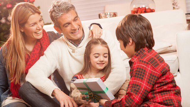 Family exchanges gifts on Christmas - Tips to Reduce Stress in Your Family Life During the Holidays