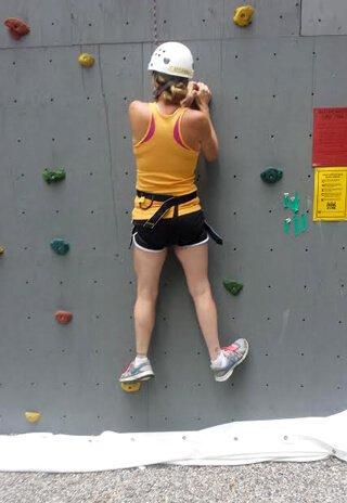 Cassandra Glynn Kutner is rock climbing