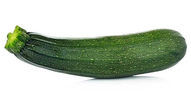 A single zucchini on a white background