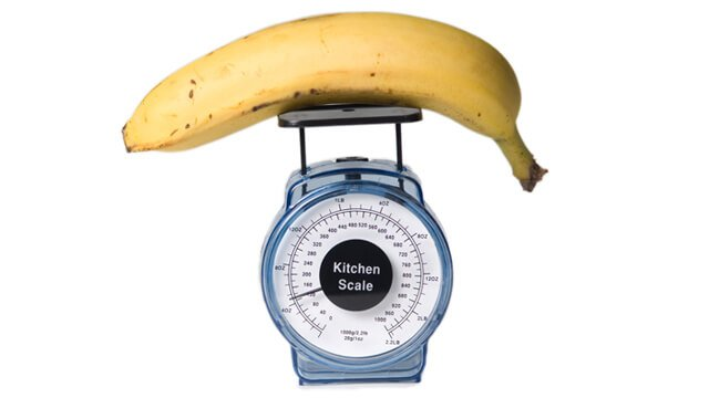 Weighing a banana on a kitchen scale