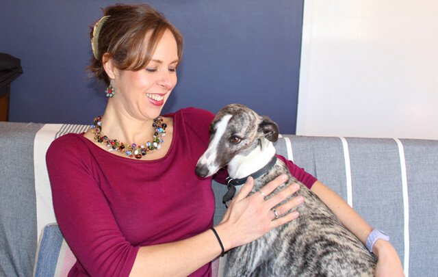 Anthea Frances Falkner pets her dog Stirling