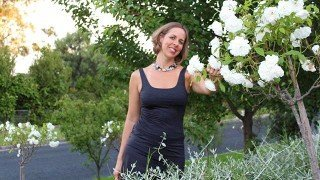 Anthea-Frances-Falkiner-touching-roses