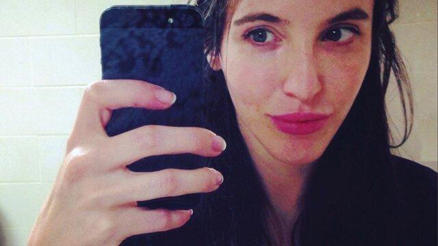 Jenny Lapan takes a self-photo in a mirror