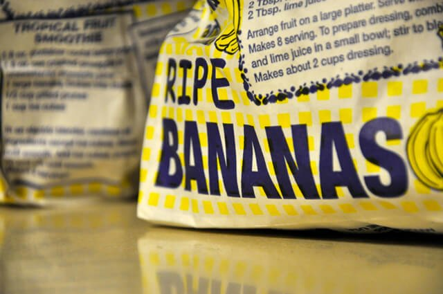 "The words ""ripe bananas"" printed on a bag of bananas"