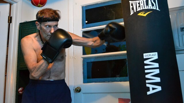 Arnold Kauffman punches a heavy bag in his home on July 21, 2012