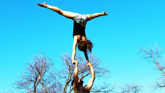 Brittany Taylor and Noah practice acroyoga