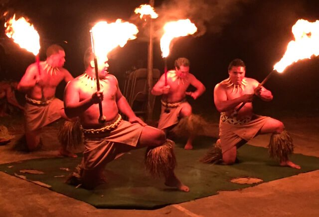 Fire dancers perform at night at The Woodstock Fruit Festival Hawaii.