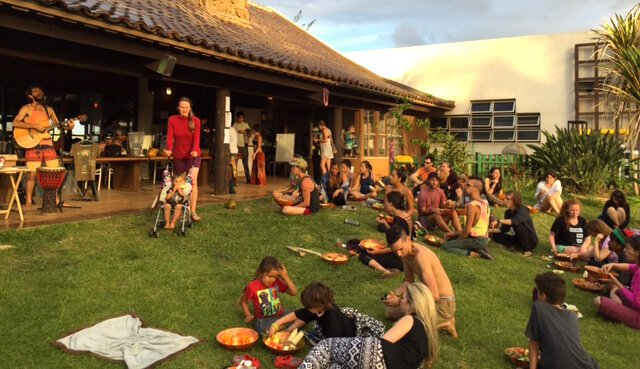 Gatherers listen to Paul Itzak perform at The Woodstock Fruit Festival Hawaii