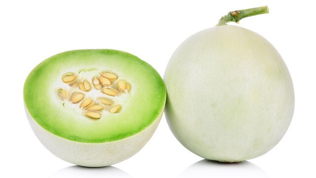 Honeydew whole and halved on white background