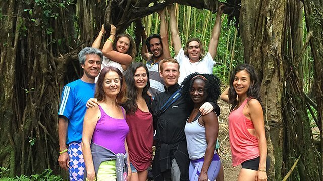 Karen Ranzi with Woodstock Fruit Festival Hawaii attendees at Manoa Falls