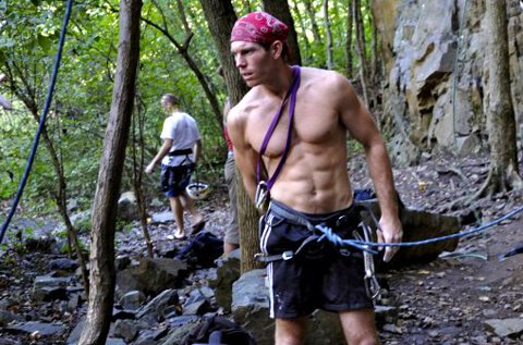 Korey Constable is photographed while rock climbing