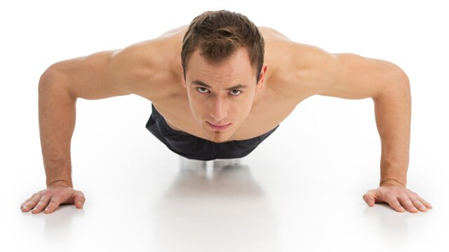 Man doing push-ups on a white background