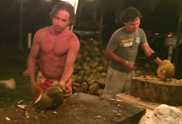 Michael Arnstein and John Kohler chop coconuts at The Woodstock Fruit Festival Hawaii