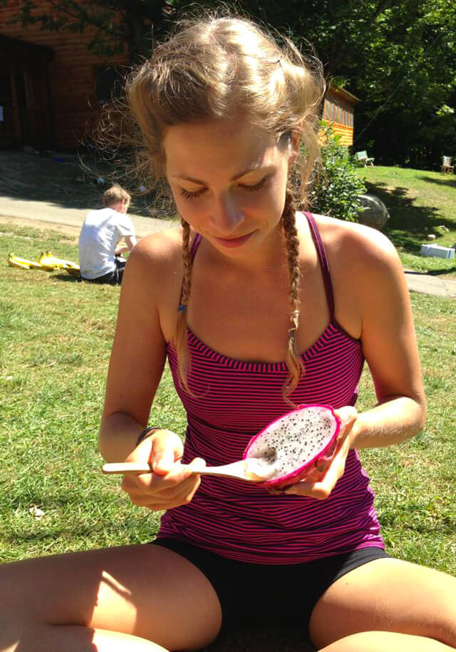 Kat Green eats a dragonfruit
