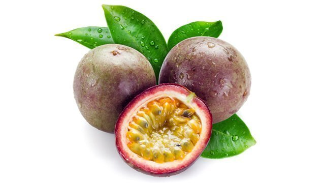 Passion fruit whole and halved on white background