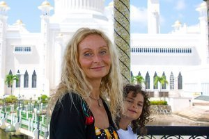 Anne and Cappi Osborne are photographed in Brunei in front of the Sultan Ali Omar Safuddin Mosque