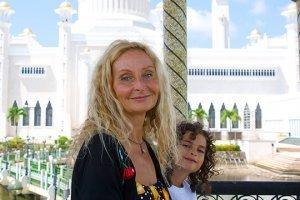 Anne and Cappi Osborne are photographed in Brunei in front of the Sultan Ali Omar Safuddin Mosque