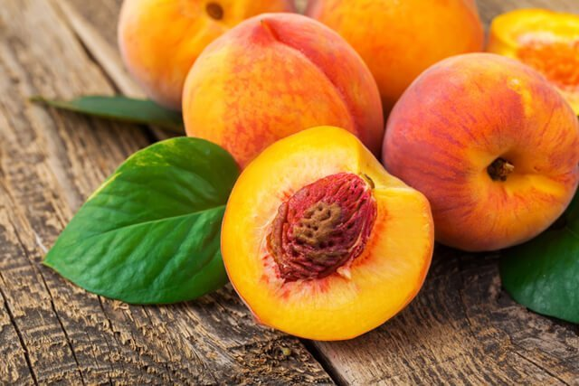 Peaches on wood background