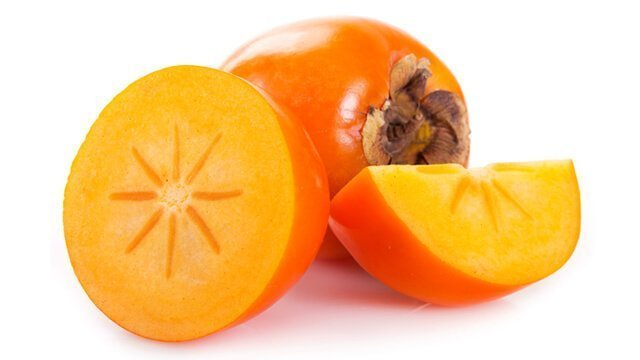 Persimmons whole and sliced open