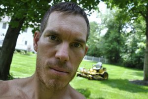 Korey Constable poses in front of a lawn