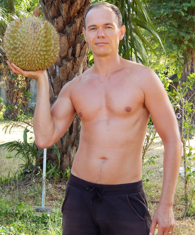 Petr Cech raises high a durian in Koh Lanta in 2014