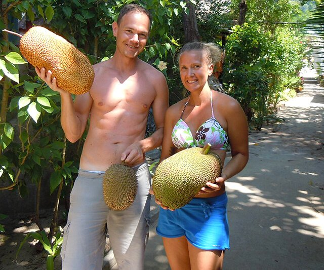 Petr and Alexandra Cech hold fruits in Koh Lanta, Thailand
