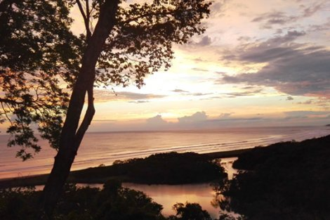A Costa Rica beach is photographed at sunset