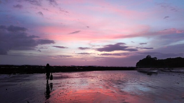 Jamie Pounds walks along a Costa Rica beach at sunset