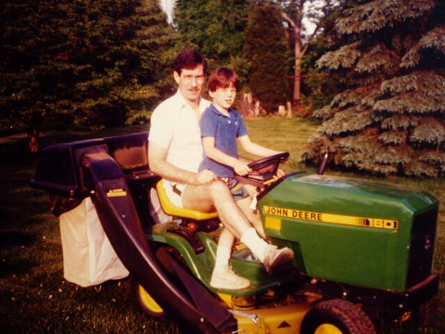 Korey Constable with his father a garden tractor