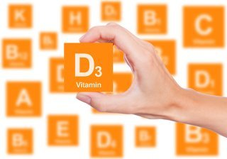 A woman lifts a Vitamin D3 block