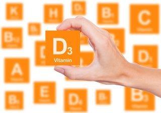 A woman lifts a Vitamin D3 block