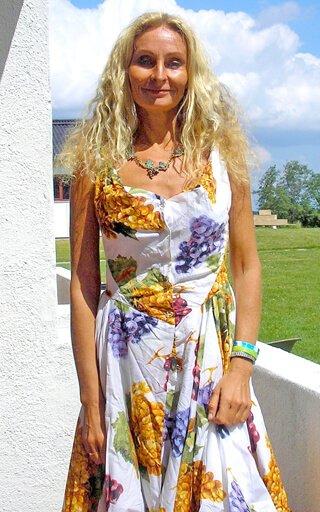 Anne Osborne smiles on the verdana of her room at the 2015 Fresh Food Festival