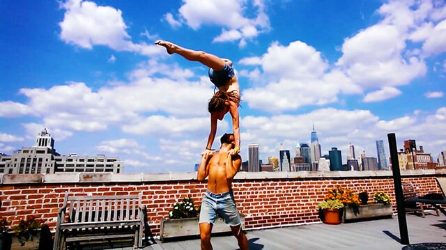 Brittany Taylor practices hand-to-hand acro on a New York City rooftop