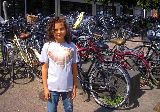 Cappi Osborne is photographed with scores of bicycles in Denmark