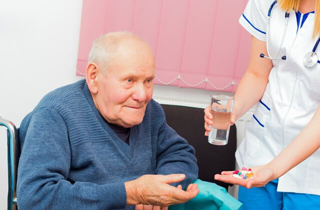 Nurse gives medication to a patient