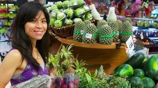 Mewsum Wong buys food in a produce aisle
