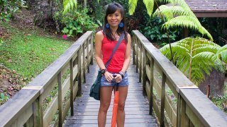 Mewsum Wong smiles while standing on a nature path